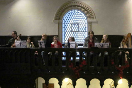 St Thomas' Music group playing in the church balcony