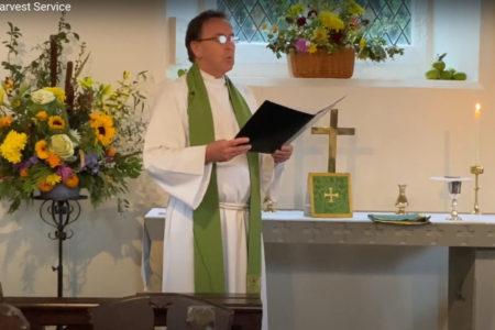 Rev Tim Dack by the altar at Trelleck Grange Church