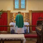 Reverend Karen Dack presiding at the altar St Marys Tregaer